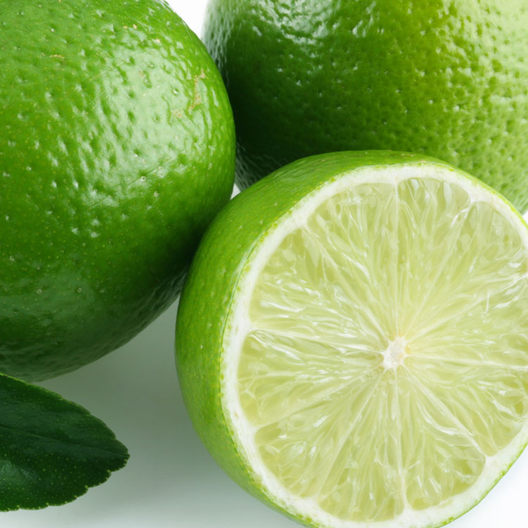 Lime with leaves on white background.